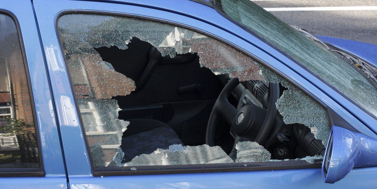 window smashed by car thief street scene royalty free image 1601056135