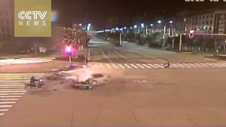 Surveillance camera records high-speed car crash